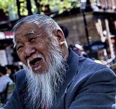 Chinese man (silvertony45) Tags: life street portrait england man colour london face closeup emotion candid streetportrait streetlife dailylife chineseman canon400d smotd