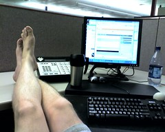 man with bare feet on desk