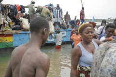 Sierra Leonean fishing village of Sulima (herwigphoto.com) Tags: africa travel fish man male horizontal youth outdoors coast fishing fisherman day adult african sierraleone westafrica youngadult development 20s realpeople wartorn colorimage sulima midadultwomen youngmanmen