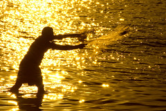 Fishing in the golden sea (Pillmann) Tags: santa sunset pordosol brazil sun sol colors brasil canon contraluz cores golden fisherman 300d 300mm dourado canonrebel santacatarina catarina pescador pescando penha fhishing superaplus aplusphoto pillmann diamondclassphotographer flickrdiamond flickrphotoaward