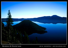 Daybreak At Crater Lake (jimgoldstein) Tags: travel blue shadow lake reflection tree tourism nature water silhouette pine oregon sunrise landscape dawn photo nationalpark bravo view searchthebest scenic cyan vista craterlake wizardisland naturesfinest blueribbonwinner supershot flickrsbest abigfave jmggalleries anawesomeshot jimmgoldstein superbmasterpiece goldenphotographer diamondclassphotographer ~flickrsbest~