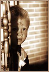 Regard discret (JL) Tags: portrait sepia nikon d70 enfant regard spia timide