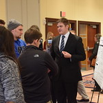 Students mingle during poster presentations.