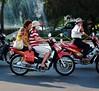Shopping Spree Bike (JanneM) Tags: street two bike shopping women jan vietnam passenger saigon hochiminh morén moren janmoren janmorén