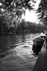 the boat and the canal (P'TITEPUCE) Tags: light bw water amsterdam boat noiretblanc flickrsbest