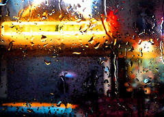 RAIN ON WINDOW (SANDIE BESSO) Tags: street blue light red paris window wet water colors rain yellow night lumix neon panasonic relief supershot outstandingshots 25faves mywinners abigfave artlibre flickrdiamond photoshopedcreations