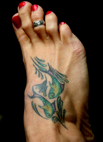 Colourfull Pisces Tattoos painted on foot.