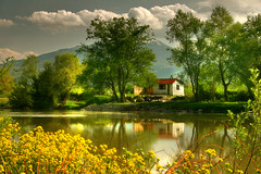 house by the river (azem) Tags: flowers trees sky house nature water clouds canon river landscape eos interestingness spring bravo deleteme10 interestingness1 hut azem kosova kosovo 2007 abigfave superbmasterpiece fiveflickrfavs fshpoetike fshnsh