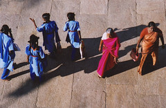 Different Directions (Qiche) Tags: street travel girls people india students walking asian temple women asia shadows walk indian persons generations tamilnadu trichy srirangam ranganathaswamy lpdown