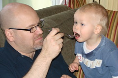 Quinn gets a bite of cake from Daddy