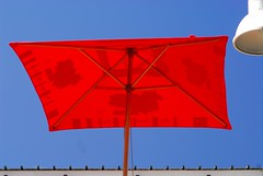 Back-lit brolly (jeremyhughes) Tags: red sky colour sunshine umbrella scarlet southafrica nikon waterfront bright explore backlit colourful d200 nikkor brolly knysna jeremyhughes nikond200 knysnawaterfront