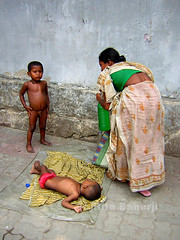 Beating the pavement heat (rita banerji) Tags: summer woman india water child pavement homeless heat thirst soe indianwomen ritabanerji 50millionmissing internationalcampaign