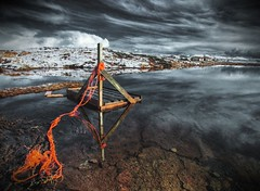 A raft ... (asmundur) Tags: wood orange reflection kids iceland pond sailing play rope raft tiedup mutedcolors hdr stables 3xp photomatix canoneos30d vogar march2007 efs10223545usm reykjavikliving