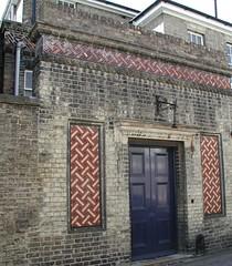 bricks & mosaics (snigl3t) Tags: cambridge wall mosaic bricks doorway tiles lattice brickwork