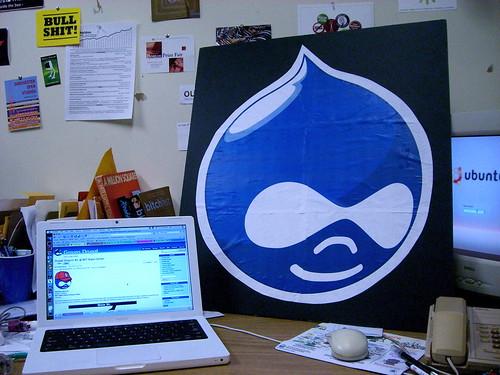 a big drupal logo, druplicon on a delevoper's desktop!