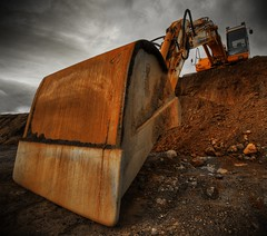 From the hole ... (asmundur) Tags: grave construction rust bravo mud digging perspective machine rusty mutedcolors dig tool hdr gravel lowangle heavyduty digg 3xp photomatix diamondclassphotographer reykjavikliving