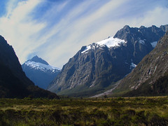 Road to Milford Sound (Danil) Tags: travel blue newzealand sky sun white mountain snow mountains ice nature beautiful rock forest landscape scenery holidays view urlaub glacier southisland bergen uitzicht milfordsound slope vacanze landschap nieuwzeeland gletsjer holidaysvacanzeurlaub