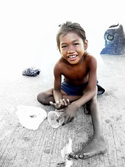 Badjao in the City (carsim) Tags: street sea portrait bw child philippines dumaguete oriental gypsy negros filtered badjao