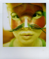 cat woman (Jersey Yen) Tags: red woman selfportrait green me cat polaroid mask beards jersey cockeyed maskedfaces almostfaces sx70sonar withoutndfilter cockeyes