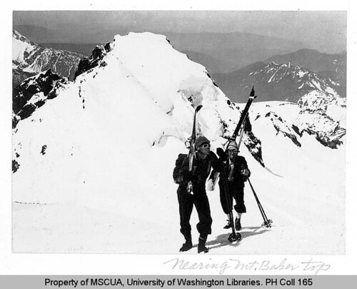 Two skiers on Black Butte spur near Mount Baker summit saddle
