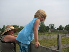 Kathi and Isabelle watch the horses
