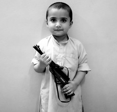 Pukhtoon Guy.. (Waseef Akhtar) Tags: light shadow blackandwhite guy smile face childhood hands gun sony akhtar waseef pukhtoon sonydscs650