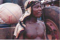 A young man in at a market stall in Lagos, Nigeria.