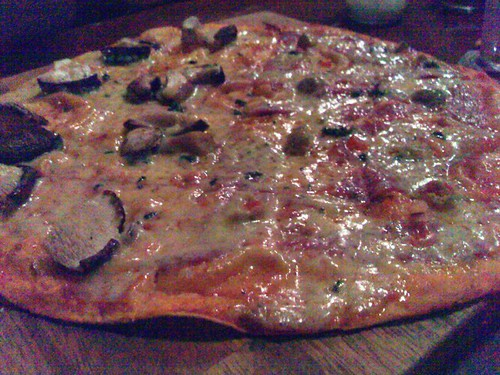 Timbre's Thin Crust Pizza with the Three Mushroom topping on the left and the salami and olive topping on the right