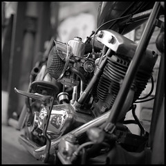 Shinjuku Chopper (mechanics) Tags: city urban blackandwhite bw white black 120 6x6 tlr film bike wheel japan rollei rolleiflex mediumformat square geotagged tokyo shinjuku asia iron dof kodak bokeh tmax engine machine harley machinery motorcycle april  nippon  shovel f28  nihon kanto mechanics 2007 planar shallowdepthoffield urbanlife 80mm shallowdepth april8 mortorcycle carburetor  shinjukuku  april2007 28fx geo:tool=gmif april82007 japaninbw geo:lon=139700185 geo:lat=35696785