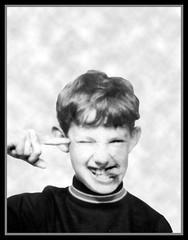 Butlitz, Mosney, Ireland (1972) - 13 Rob in photobooth fun (marmaset) Tags: boy portrait blackandwhite me face self john booth photobooth rob scanned lad passport robjohn mosney