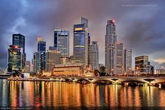 Singapore Skyline (#12) (Christopher Chan) Tags: city travel skyline night skyscraper canon singapore slideshow 1785mm fullerton 4k 30d mostviewed uobplaza republicplaza interestingness12 oubcentre i500 top20flickrskylines superaplus diamondclassphotographer flickrdiamond