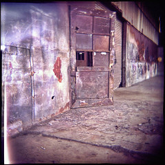 Warehouse door (Otto K.) Tags: door atlanta urban abandoned film holga rust industrial fuji toycamera warehouse deserted decayed castleberry pro800z ottok