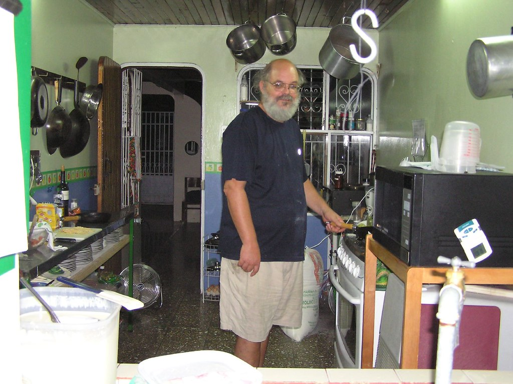 Johns cooking in his kitchen, Orosi