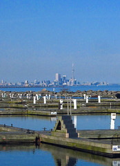 Toronto in the Distance (A Great Capture) Tags: wood city lake toronto ontario canada building tower monument water wall cn port docks nice rocks warm day tour hometown ashley ad landmark icon can calm structure credit april to lakeontario mississauga iconic whereilive touristattraction breaker attraction 2007 on wodden spirng portcredit ald canadianphotographer worldfederationofgreattowers scoopt tourcn torontophotographer ash2276 ash2275 ashleyduffus canadianphotogpraher ashleysphotography ald ashleysphotographycom ashleysphotoscom ashleylduffus wwwashleysphotoscom