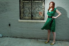 Mikhaela with scroll window, green dress blowing in wind