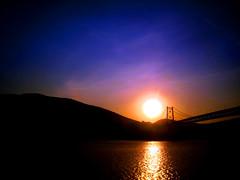 west (JKnig) Tags: bridge blue sunset orange sun west reflection water train river bearmountain hudsonriver lucindawilliams nope hudsonvalley bearmountainbridge goodpeople hudsonhighlands nuhuh takenfromthetrain itsthelittlethings fuckinaye hudsonhudsonhudson heyguesswhat iwentcanelesstoday foundabetterkneebracetoo igetthemriresultstomorrow itsasmundaneasmundanegets metduffandhiswomanfordrinksattheoysterbar idneveractuallybeentotheoysterbar orthewhisperingarches wasworththewaitthotoseemichaels12yearoldgleeasheshowedmethearches suchafabulousalbum addittothelist wishidgottenitfromsomethingsexierlikeaskiingaccidentorgettingtrampledbyawildkangarooorfallingthroughamoldywoodenfloorinanabandonedbuilding ireferredtothisshotintagsrecently sohereyagoasrequested youknowlikewalking allthisfromasimpletwistoffatewhileslidingintomytrainseat thothepainwasnotmundane buttodayiskippedthesubwayandwalkedthetenblocksbacktogct nothinglikeseeingfriendsandsippingreadchuggingatanquerayandtonictoendaworkingday plusigottoseemoreofgrandcentral iadorethatboy himandmicheleman