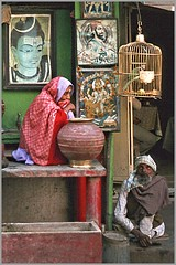 longing - giving water to pilgrims,  Mathura, India, 1979 (ianpwatkinson) Tags: woman india water temple devotion hinduism oldcity pilgrims mathura globalspirit abigfave colorphotoaward theindiatree