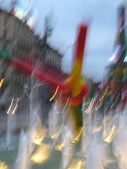 Between The Sprays...... (rogilde - roberto la forgia) Tags: city light vacation milan water beauty canon hp milano spray luci acqua colori fontana coolest luce italians vocation supershot flickrsbest nikonstunninggallery abigfave impressedbeauty superbmasterpiece