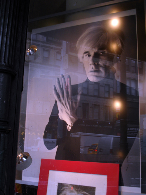 photo of Andy Warhol in window