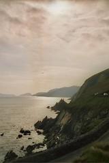 'The sea is calm tonight/ The tide is full...' (Isabel :)) Tags: ireland sea cliff mer bird beach rock meer dingle irland kerry atlantic fels oiseau rocher vogel irlande felsen sleahead ozean klippe