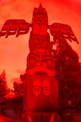 Blood Sky Totem (cwgoodroe) Tags: bear park wood sculpture art digital oakland bay eyes colorful paint bright eagle pentax native hawk d totem carving historic nativeamerican area totempole ist