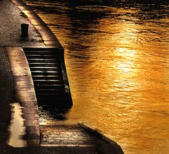 water on fire (Dan65) Tags: vienna sunset orange sun reflection water yellow stone stairs river austria canal bravo path steps quay explore 34 danube donaukanal goldenphotographer franzensbrcke