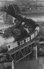 Pittsburgh Herrs Island Bridge B&O train 1974 (Ivan S. Abrams) Tags: pictures county arizona bw gm pittsburgh pennsylvania ivan detroit getty bo freighttrains abrams allegheny londonontario gettyimages generalmotors smrgsbord tucsonarizona bando emd baltimoreandohio railroadbridges 12608 railwaybridges diesellocomotives blackwhitephotos electromotive emdlocomotives lagrangeillinois electromotivedivision ustrains helperlocomotives onlythebestare dieselelectriclocomotives ivansabrams trainplanepro riverherrsisland gplocomotives trainsmoving trainspennsylvania bridgesalleghenycountypennsylvania pimacountyarizona safyan arizonabar arizonaphotographers ivanabrams cochisecountyarizona tucson3985 gettyimagesandtheflickrcollection electromotivediesel copyrightivansabramsallrightsreservedunauthorizeduseofthisimageisprohibited tucson3985gmailcom ivansafyanabrams arizonalawyers statebarofarizona californialawyers generalmotorsdiesel copyrightivansafyanabrams2009allrightsreservedunauthorizeduseprohibitedbylawpropertyofivansafyanabrams unauthorizeduseconstitutestheft thisphotographwasmadebyivansafyanabramswhoretainsallrightstheretoc2009ivansafyanabrams abramsandmcdanielinternationallawandeconomicdiplomacy ivansabramsarizonaattorney ivansabramsbauniversityofpittsburghjduniversityofpittsburghllmuniversityofarizonainternationallawyer