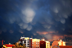 I watch it getting closer (*maya*) Tags: city sunset sky storm milan weather clouds town tramonto nuvole milano cielo thunderstorm tempest pioggia coolest buldings closer città temporale tempesta rho mammatus raint