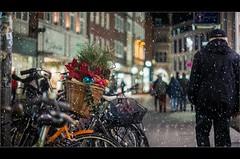 Xmas-time (Zino2009 (bob van den berg)) Tags: münster city centre kerstmarkt outside cold winter wintertime xmastime loveit happy light man walking cycle bicycle ornage hollandbike mand basket decoration colors zino2009 169 bob
