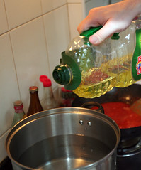 24: Olive oil into water