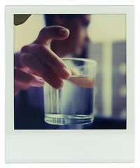Are you thirsty? (Cea tecea) Tags: topf25 water glass reflections polaroid sx70 topv333 agua dof hand thirst sed vaso lovepolaroid