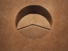 Sandstone portal. (RichTatum) Tags: wallpaper brown abstract texture architecture landscape sand nikon shadows background feel tan adobe round portal rough stark textured tactile nikon3200 blogrodent richtatum