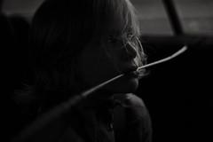 I don't believe in god (Dalla*) Tags: boy kid child straw profile silhouette shadow windowlight car portrait bw monochrome wwwdallais