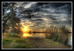 Clouds of the Sun (sunsurfr) Tags: blue trees sunset sky orange sun reflection tree green clouds photoshop gold golden nikon waves d200 soe hdr gulfshores photomatix tonemapping nikonstunning superaplus aplusphoto sunsurfr